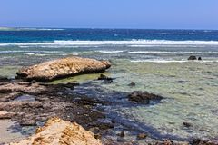 Seashore with the rocks. In Egypt royalty free stock photography