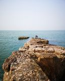 A great rock and the Bohai Sea stock photography