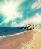 Seashore with rocks Stock Photos