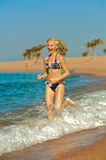 Seashore running Stock Image