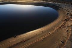 Seashore sand beach perfect circle Stock Photos