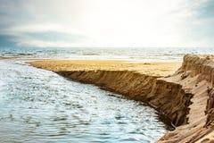 Seashore scene at sunset time. Beautiful seascape. Stock Image