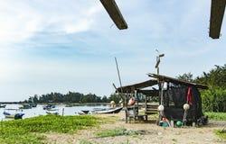 Seashore scenery at Terengganu, Malaysia. Dirty white fish net b Stock Photography