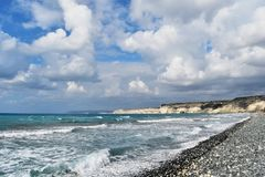 Seashore. With beautiful wavy deep blue sea and cloudy blue sky Stock Image