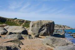 Seashore, sky, blue water, Caspian sea. Seashore, rocks, blue sky royalty free stock photography