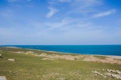 Seashore, sky, blue water, Caspian sea. Seashore, rocks, blue sky royalty free stock photo