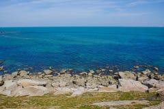 Seashore, sky, blue water, Caspian sea. Seashore, rocks, blue sky royalty free stock photos
