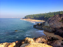 Seashore with stones and palm trees. India. Kerala. Royalty Free Stock Photos