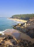 The seashore with stones and palm trees. India. Kerala Royalty Free Stock Photos