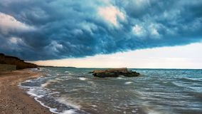 Seashore stormed with dramatic clouds, nature. Landscape royalty free stock images