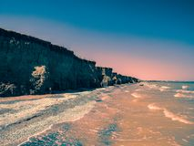 Seashore stormed with dramatic clouds, nature. Landscape stock image