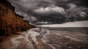 Seashore stormed with dramatic clouds, nature. Landscape stock images