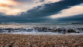 Seashore, stormy sea stock photography