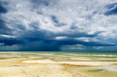 Stormy sky and beach at low tide Royalty Free Stock Images