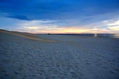 Seashore Sunrise on a Summer Morning. The sunrises over the ocean on a summer morning at the shore Royalty Free Stock Image