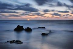 Seashore after sunset Stock Photos