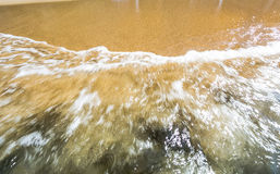 Seashore texture water foam over sand Royalty Free Stock Image