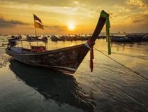 Traditional thai boats at sunset beach Royalty Free Stock Photos