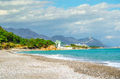 Seashore in Turkey, Kemer. Seashore with blue water and mounains in Turkey, Kemer Stock Images