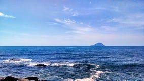 Seashore Under Blue Sky Stock Photography