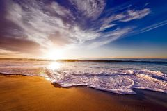 Seashore Under White and Blue Sky during Sunset Royalty Free Stock Photo