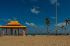 Seashore view with huge colorful stage shelter aside for people to rest, Chennai, India, Feb 19 2017 Stock Photos