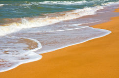 Seashore with waves and foam Stock Photography