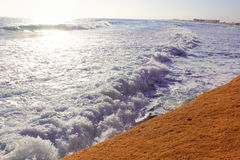 Seashore Waves and Mountain under the Sunshine in Matrouh, Egypt Royalty Free Stock Image