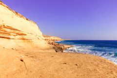 Seashore Waves and Mountain under the Sunshine in Matrouh, Egypt Royalty Free Stock Images