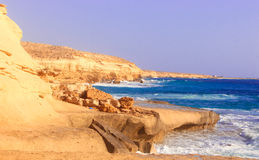 Seashore Waves and Mountain under the Sunshine in Matrouh, Egypt Stock Photo