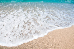 Seashore, waves and sandy beach Stock Photo