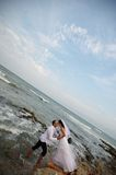 Seashore wedding (bride and groom). Beautiful newlyweds couple posing in the sea water stock photos