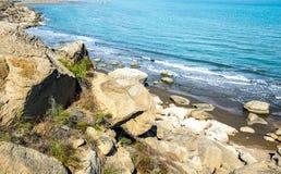 Wild beach with protruding rocks. Seashore, wild beach with protruding rocks stock photos