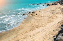 Wild beach with protruding rocks. Seashore, wild beach with protruding rocks royalty free stock photos