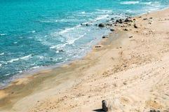 Wild beach with protruding rocks. Seashore, wild beach with protruding rocks royalty free stock photo