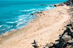 Wild beach with protruding rocks. Seashore, wild beach with protruding rocks royalty free stock photography
