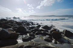 Seaside. A bright stoney beach in South Africa Royalty Free Stock Images