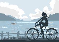 On seaside. Biking girl Enjoying Seasite View Royalty Free Stock Photos