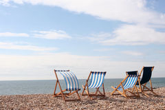 Beside the Seaside. Empty deckchairs on the beach at Bognor Regis Sussex England royalty free stock photo