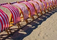 Seaside. A row of deck chairs in the wind Royalty Free Stock Photography
