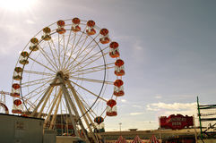 Seaside amusement park with big wheel Stock Photo
