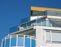 Seaside appartment building. Sunny detail on a modern appartment building stock photos