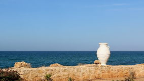 Seaside background with Greek amphora vase. Simple background illustrating Greece - amphora reminds about rich culture and history of the country, clear sky and stock video footage