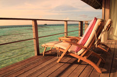 Seaside balcony with two chairs. Two deck chairs on a sea view balcony at a tropical resort in Maldives stock images