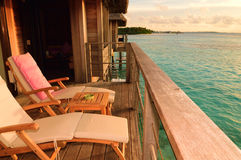 Seaside balcony with two chairs. Two deck chairs on a sea view balcony at a tropical resort in Maldives stock photo