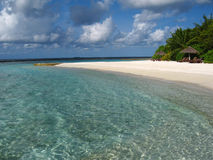 Seaside Beach. Dreaming beach with the transparent sea water in Maldives Stock Photos