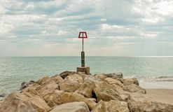 Coastal rocks scene along Bournemouth beach in Dorset. Royalty Free Stock Image
