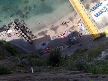 Seaside beach in Sorrento. Marina piccola, consisting of a wooden platform supported by iron poles in the sea, seen from the municipal villa, and also visible Royalty Free Stock Image