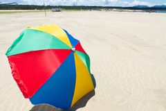 Seaside beach umbrella Stock Photos