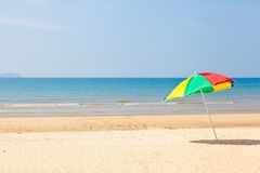 Seaside beach umbrella Stock Photography
